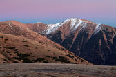 A frosty sunset panorama in beauty mountains from peak Strazov — Stockfoto