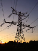 Electricity pylon on sunset - power energy — Stock Photo