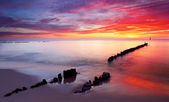 Baltic sea at beautiful sunrise in Poland beach. — Stock Photo