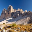 Dolomites mountain panorama in Italy at sunset - Tre Cime di Lav - Stock Photo