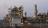Oil and gas industry - refinery at twilight - factory - petroche — Stok fotoğraf