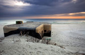 Bunker on beach in sunrise — Stock Photo