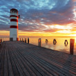 Lighthouse at Lake Neusiedl at sunset - Stock Photo