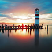 Ocean lighthouse sunset — Stock Photo