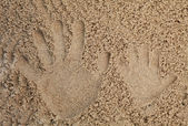 Father and son hand print in sand — Stock Photo