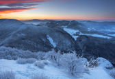 Frosty sunset panorama in beauty mountains — Stock Photo