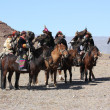 Senior Mongolians horsemen in traditional clothing — Stock Photo