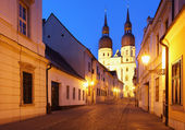 Historical street in Trnava with Saint Nicolas church — Stock Photo