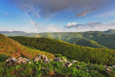 Rainbow in green mountain — Stock Photo