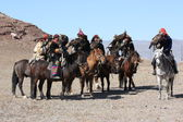 Senior Mongolians horsemen in traditional clothing — Stock Photo