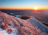 A frosty sunset panorama in beauty mountains from peak Strazov — Stock Photo