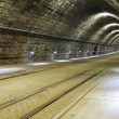 A tram disappearing into a tunnel — Stock Photo