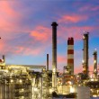 Oil and gas refinery at twilight - Petrochemical factory — Stock Photo #27698193