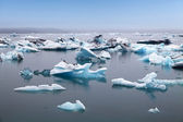 Blue icebergs floating in Jokulsarlon glacial lagook, Iceland — Stock Photo