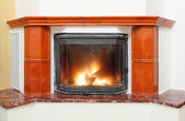 Fireplace in house interior — Stock Photo