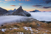 Mist in the mountain . In the dolomites - passo Valparola — Stock Photo