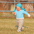 Happy little boy running — Stock Photo