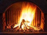 Fireplace with fire — Stock Photo