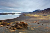 Lake in Reykjanes with black lava field — Stock Photo