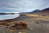 Lake in Reykjanes with black lava field — Stock Photo