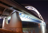 Bridge in Bratislava downtown during night. Slovakia. Name of br — Stock Photo