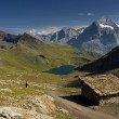 Swiss Alps with the hut — Stock Photo #34315567