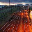 Railroad track at night with colorful sky — Stock Photo #36071055