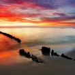Poland, Ocean sunset on beach. — Stock Photo