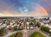 Reykjavik cityspace with rainbow — Stock Photo