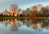 Church with reflection in pond, Cifer — Stock Photo