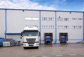 Shipping cargo truck at warehouse building — Stock Photo
