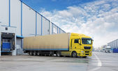 Cargo Transportation - Truck in the warehouse — Stock Photo