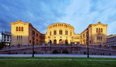 Oslo stortinget parlament při západu slunce, norsko — ストック写真