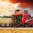 Wheat field with Harvester machine — Stock Photo #49883849