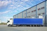 Truck in warehouse — Stock Photo