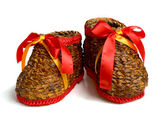 A pair of handmade weaving boots with red ribbon — Stock Photo