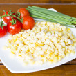 Royalty-Free Stock Photo: Frozen corn, fresh tomatoes and chives