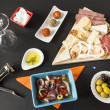 Appetizers and cheese plate - Stock Photo