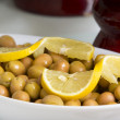 Green olives with lemon — Stock Photo