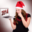 Santa Claus holding a laptop — Stock Photo