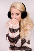 Winter girl with earmuffs — Stok fotoğraf
