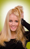 Blond girl with green background — Stock Photo