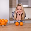 Young woman in the kitchen — Stock Photo #41149903