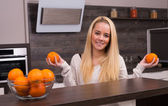 Young woman in modern kitchen — Foto de Stock