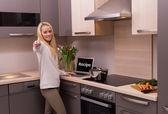 Woman in modern kitchen — Stock Photo