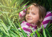 Green grass and smiling. — Stockfoto