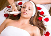 Beautician face treatment — Stock Photo