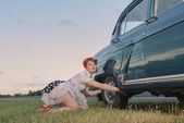 Woman Changing a Tire — Stock Photo