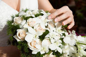Bouquet with bride hand — Stock Photo