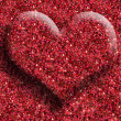Stock Photo: Red heart on red background